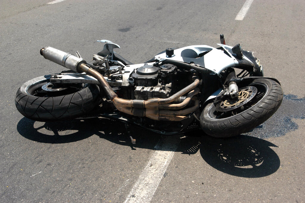 Motorcycle fallen in road after accident injury lawyer